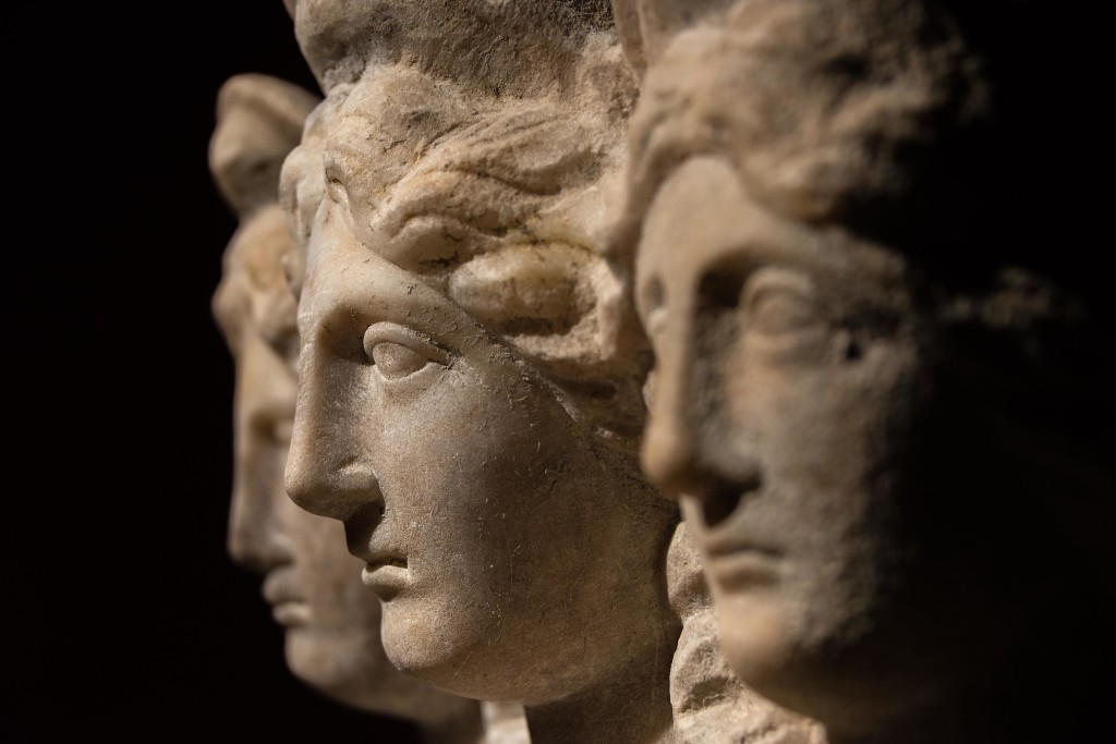Three headed roman-asian ancient statue of beautiful women